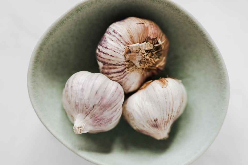 cloves of garlic on a wood table